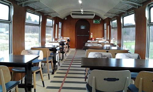 Inside the Dining Car. Look at the 'track' design in the floor covering.