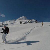 Me and my dad skiing, this was the first time I had ever done something like this.. being in the avalanche backpack and making fresh tracks down the whole slop