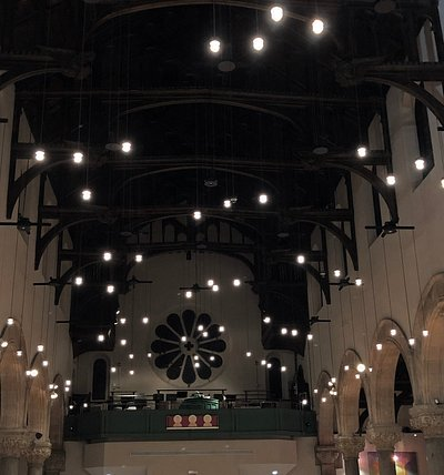 The lights in the sanctuary seem to float in the air.
