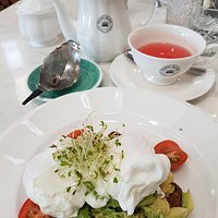 Her Ladyship smashed avo with poached eggs on wholegrain toast with Harney & Sons spiced plum tisane... what a regal presentation.