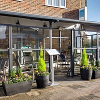 Outside dining area with adjustable screens, retractable canopy, heaters and lighting