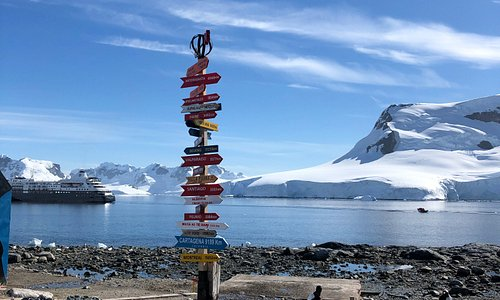 Signpost, reminder of how far we are from the world