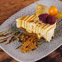 Baileys cheesecake with espresso sauce and gingerbread crumble