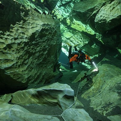 Curious about the mysteries of the mountains? Join one of our cave courses to get a taste of how it is to float weightlessly around in the huge halls of natures own art. No tight spots - just crystal clear water, improved diving skills and fun! Photo: Pekka Tuuri