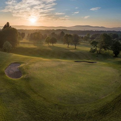 Beautiful picture of the 12th Green as the sun is setting over the Angus hills