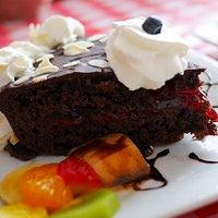 Black Forest Cake with whipped cream and fruit