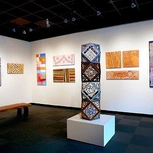 Australian Aboriginal painters at ArtXchange Gallery with sculpture by June Sekiguchi