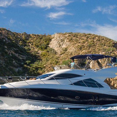 Our Sunseeker Manhattan, cruising Cabo Bay.