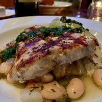 Outstanding grilled sword fish with sauce verde and butter beans