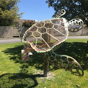 A Sea Turtle Sculpture made of metal from artist Jim Swain is on display on the Museum grounds.