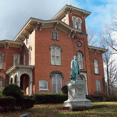 Front of the Fenton Mansion with a statue of former Governor Reuben Fenton