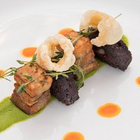 Pork Belly with black pudding, pea puree and crackling