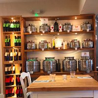 Casa Toscana olive oils and traditional balsamic vinegars, used in the restaurant cuisine and available for sale in refillable bottles.