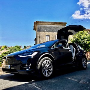 Tesla Model X in Saint-Emilion in front of monolithic church