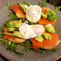 From our Brunch Menu - Smoked salmon, avocado and poached egg on a lightly toasted bagel.