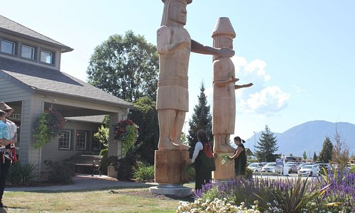 Sto:lo Welcome figures, designed and hand carved onsite to welcome guests to the visitor center and our community.