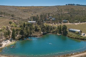 Birds eye view of our lake, beach and trailers on the hillside