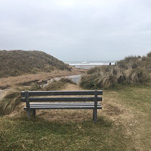 Stunning scenery along this stretch of Anglesey Coast path. Beach is easily accessible from Rhosneigr.  Good for walkers , families, surfers , dog friendly . Backed by dunes and Anglesey Coast path .
