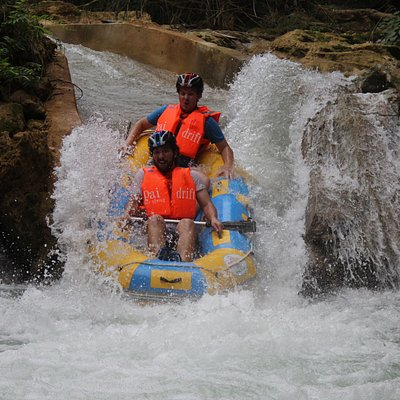 Laos peaceful and wild forest pure pristine river rafting near Luang Prabang Waterfalls that is one of the top 10 world famous inspiring natural pools.