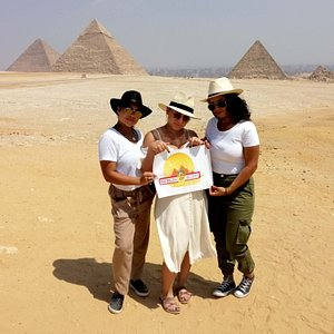 Three angels in front of the pyramids of Giza