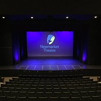 The auditorium and stage of the Newmarket Theatre as seen from the back row.