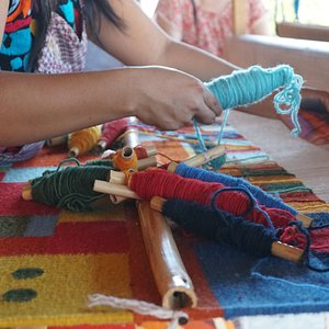 The weaver making a beautiful piece of art.