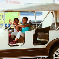 Travel back in time in the climb-on car. Located inside Sloan Museum at Courtland Center.