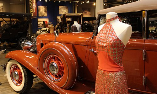 Classic American cars and exquisite antique fashions are paired throughout the museum.