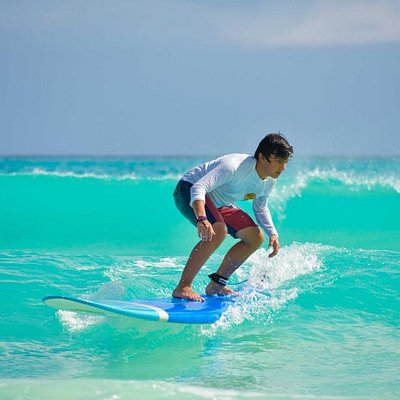 One hour lesson and he looks like a pro. Learn to surf with Good Vibes Surf School