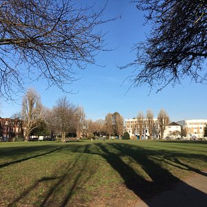 Long shadows, late afternoon, a sunny day at Stamford Brook Common