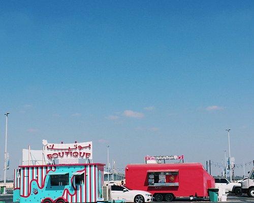 Colorful food trucks all around