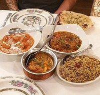 chicken tikka masala, lamb bhuna, paneer and pea curry from sides, keema rice and chilli garlic naan