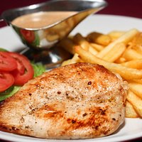 Chicken fillet serve with french fries and pepper sauce.