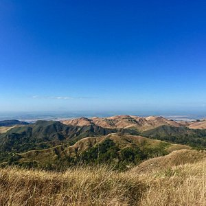 The summit (chocolate hills of the north as background)