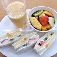 Fruit combo, with fruit sandwiches, a mixed fruit drink, and kudzu fruit.