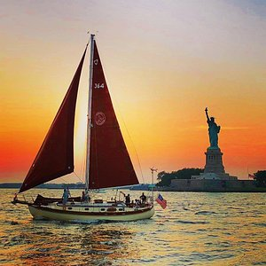 The Genesis sailing by the Statue of Liberty during a sunset charter!