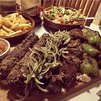 kebab , barbeque , fri,  salat,  vegetables  cheese and vodka for only 150 Eur for 4 peron.