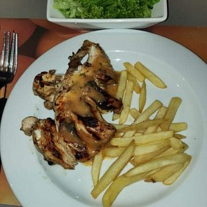 Chicken fillet grilled with French Fries and lettuce salad
