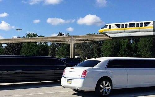 We transport the happiest passengers in stretch limousines at Walt Disney World Resorts and both Orlando International Airport (MCO) and Sanford International Airport (SFB) 24 hours a day, 365 days a year. Call and Check Availability as the black limo displayed here can accommodate up to 8 people w/ 7 med/lg bags maximum whereas the white limousine can seat up to 10 and only up to 5 med/lg bags. Boosters & Child Seats available as well as ice and bottled water, all complimentary. Call NOW!