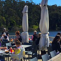 Our expansive outdoor deck area, over Lake Daylesford. The perfect place for lunch or dinner with family and friends on a sunny day.