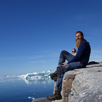 Whale and iceberg spotting while taking a break on one of our hikes