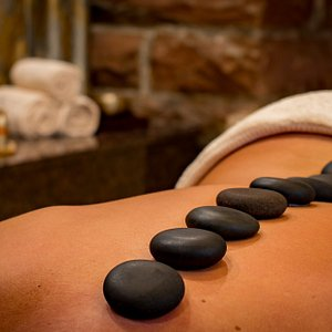 Authentic Thai Hot Stone Massage Thoroughly relaxing for the mind and Body. This Therapy is a deep relaxing massage offering many benifits such as Pain relief,improving flexibility, can be helpful to reduce stress and anxiety. Massage in general helps to relax muscles and the hot stone can further enhance this therapy resulting in more flexibility and less painful  to your joints. Overall this is a great therapy to reduce stress ,anxiety , reducing pain and giving better sleep paterns.