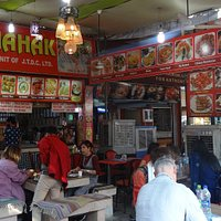 This is the picture of the Mahak stall in Dilli Haat where you cannot enjoy one of the best meals of your life. You can see tourists and visitors enjoying their meals. Governor Amolak Rattan Kohli