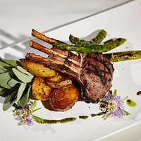 Agnello Scottadito ~ Succulent Australian rack of lamb chops marinated with lemon and fresh herbs grilled to perfection. You will lick your fingers!