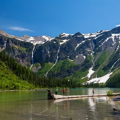 Hike two miles through the Trail of the Cedars and along a creek to get to Avalanche Lake on the west side of Glacier National Park. Because of its low elevation, this trail is one of the first to open for the summer season in May.  https://www.yellowstonepark.com/tag/glacier-national-park