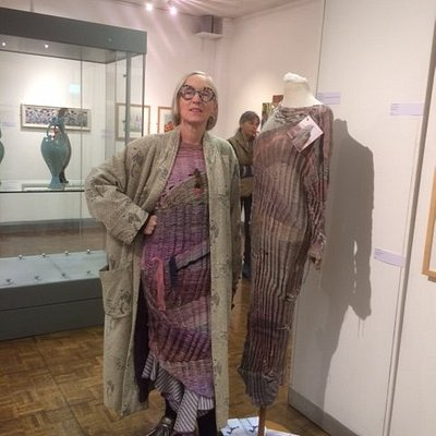 Joan Murray knitwear designer; her standing stone inspired outfit in Skipton before their art gallery closed for refurbishment.  Hope you'll invite her over, the garment has great detailing.