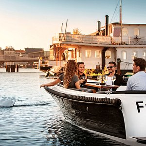 """Explore Copenhagen in your own electric boat - the best """"hygge"""" cruise in town."""