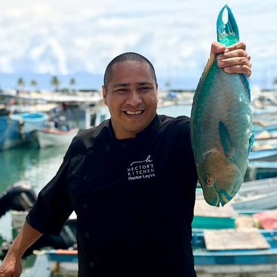 Chef Hector holding a parrot fish