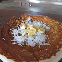 Pancake was huge and delicious with fresh coconut and banana.