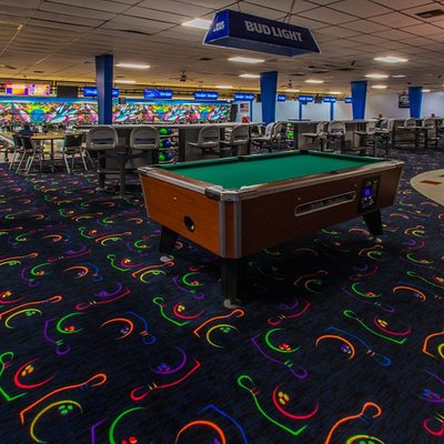 Our main corridor features a pool table and plenty of room and seating!